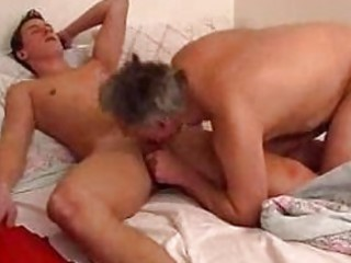 mature homo dad gives young guy a blowjob in sofa